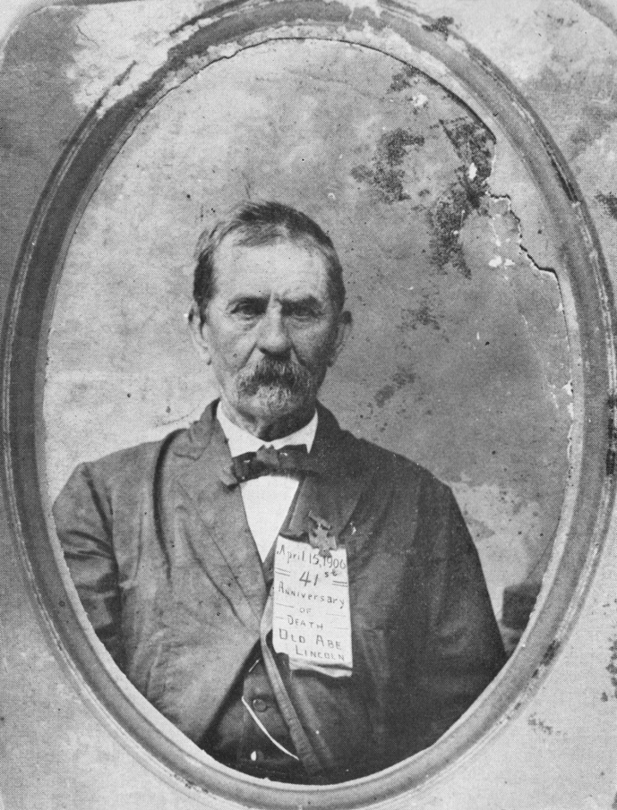 Pink Parker on April 15th, 1906 - The day he erected his monument to Booth.  Notice his paper badge celebrating the 41st anniversary of Lincoln's death.