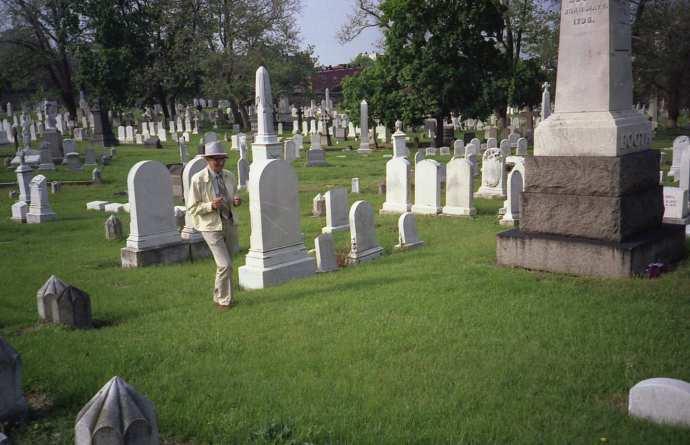 John C. Brennan dowsing for John Wilkes' grave on the Booth family plot in Green Mount Cemetery in 1988.
