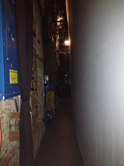 The back wall of Ford's Theatre from backstage.  When Booth tried to go across here, there was not enough room.